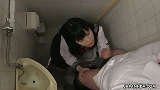 Filthy Japanese student Sayaka Aishiro gives a blowjob with an increment of tugjob in the toilet