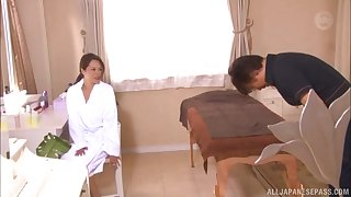 Asian MILF oiled up before a kneading and a blowjob