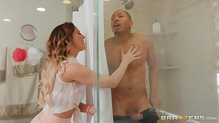 Cherie Deville gets her wet pussy fucked away from a friend in the shower
