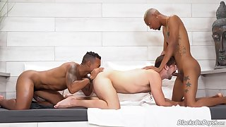 Black hunks are enjoying twink ass close to derisive threesome