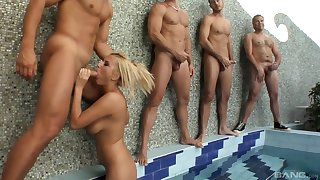 Myra Lyon is on her knees coupled with goes around sucking hard cocks