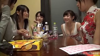 Two Japanese lesbians pleasuring a babe with snug tits